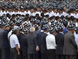 Uzbek man gather to pay their last respects during the funeral of President Islam Karimov at the historic Registan Square in Samarkand, Uzbekistan, Saturday, Sept. 3, 2016. Karimov, whose harsh and ill-tempered rule governed Uzbekistan for a quarter-century, is to be buried in his home city of Samarkand. (AP Photo)